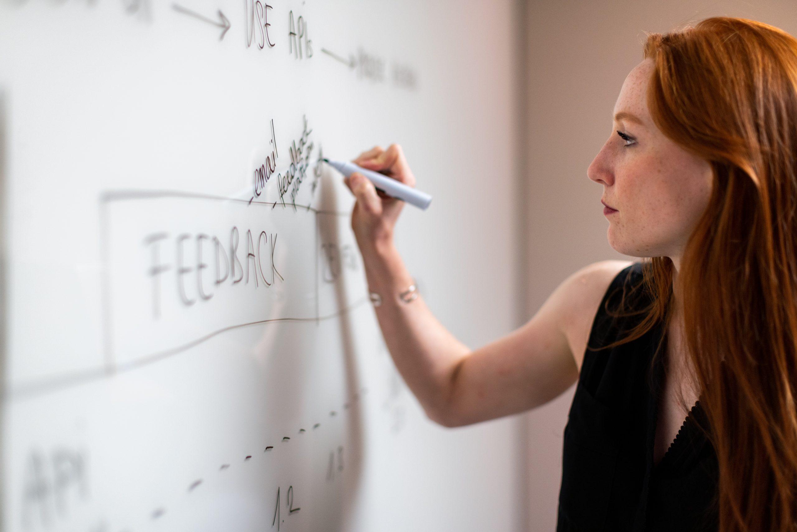 Girl writing on whiteboard